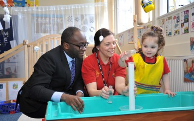 Education Minister Sam Gyimah with Sam Martin, neighbourhood development worker, and Imogen Sickling in the Tiny Steps provision for two-year-olds